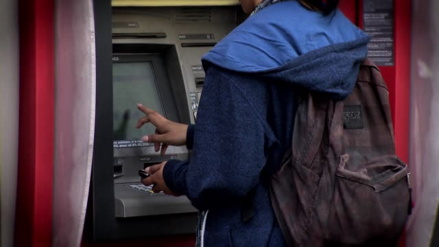 people using bank of america atms - bank of america stock videos & royalty-free footage