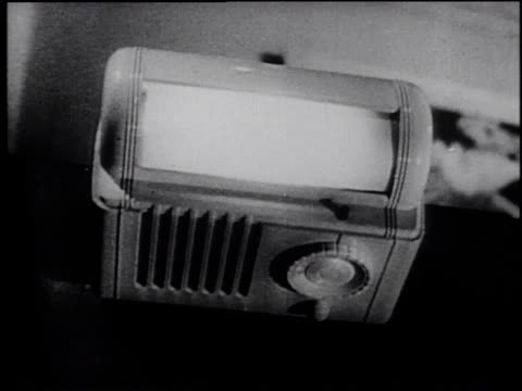 1945 montage people using different radios / united states - frank capra video stock e b–roll