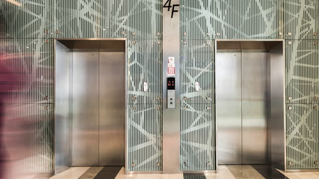 people using elevators inside shopping mall
