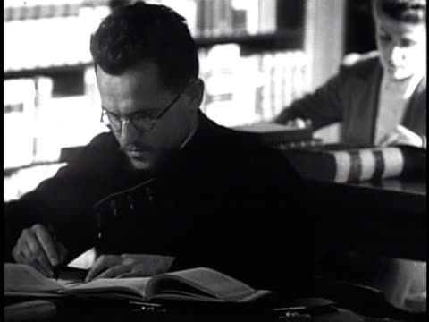 people using library in the print reading room priest reading while walking by book shelves priest standing second story reference book shelves - priest stock videos and b-roll footage