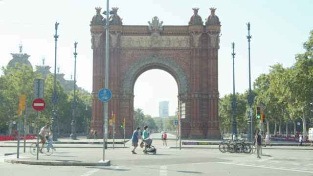 people using masks at barcelona during covid-19 crisis. arc de triomf - spain stock videos & royalty-free footage