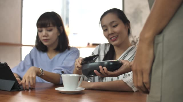 people using mobile phone for contactless payment, mobile payment - near field communication stock videos & royalty-free footage