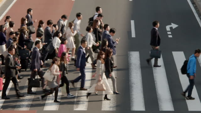 people using pedestrian crossings in tokyo - moving past video stock e b–roll