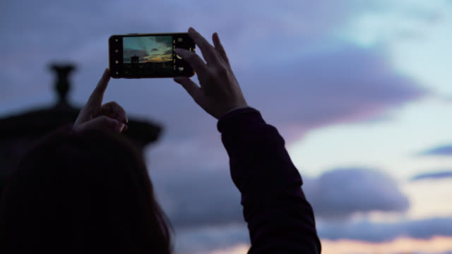 people using their smartphones on calton hill - communication stock videos & royalty-free footage