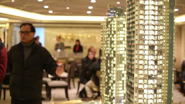 people view a model of an apartment of the avenue a residential property codeveloped by sino land co hopewell holdings ltd and the urban renewal... - wanchai stock videos and b-roll footage