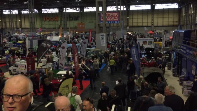 people view some of the classic cars that are being displayed on the first day of the lancaster classic motor show at the nec birmingham on november... - tradeshow stock videos and b-roll footage