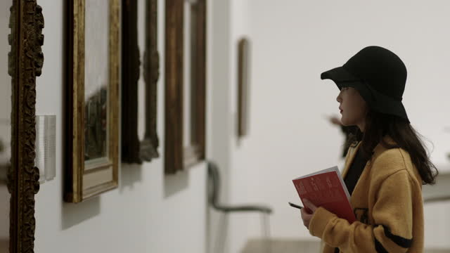 people viewing art at a gallery, uk - art and craft stock videos & royalty-free footage