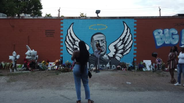 people visit a memorial and mural that honors george floyd at the scott food mart corner store in houston's third ward where mr. floyd grew up on... - mural stock videos & royalty-free footage
