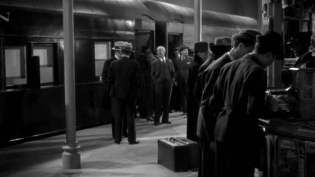 people visit a newsstand in a busy train station. - 1936 stock videos & royalty-free footage
