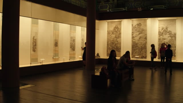 people visit a traditional chinese painting show in forbidden city on may 02 2017 in beijing china - kunst, kultur und unterhaltung stock-videos und b-roll-filmmaterial