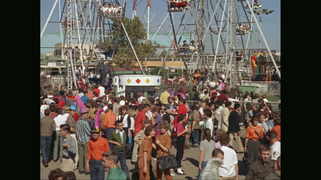 ws people visit amusement park at the state fair of texas / united states - fairground stock videos and b-roll footage