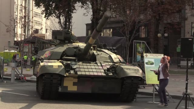 people visit an exhibit in the centre of kiev of more than 70 units of weapons and military equipment used by the army which has been fighting armed... - separatism stock videos & royalty-free footage