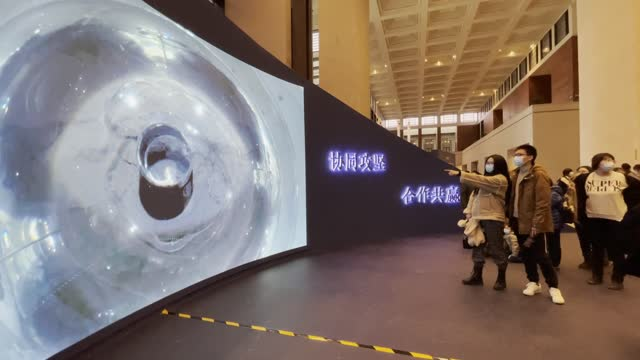 people visit an exhibition displaying the lunar samples no. 001 brought back by china's chang'e 5 probe at the national museum of china on february... - 中国国家博物館点の映像素材/bロール