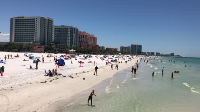 people visit clearwater beach after governor ron desantis opened the beaches at 7am on may 04 2020 in clearwater florida restaurants retailers... - florida us state stock videos & royalty-free footage