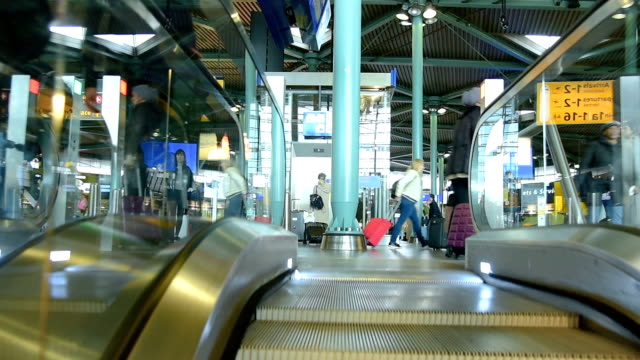 people visit departure hall in international schiphol airport at day time - automatic stock videos & royalty-free footage