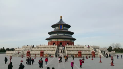 people visit famous temple of heaven on feb 20, 2017 in beijing, china. temple of heaven is one of the unesco world heritage site. - unesco world heritage site点の映像素材/bロール