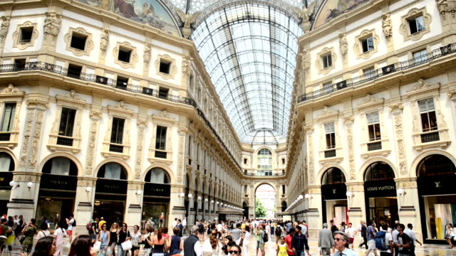 people visit galleria vittorio emanuele ii during a hot summer day the galleria vittorio emanuele ii is one of the world's oldest shopping malls it... - galleria vittorio emanuele ii stock videos and b-roll footage