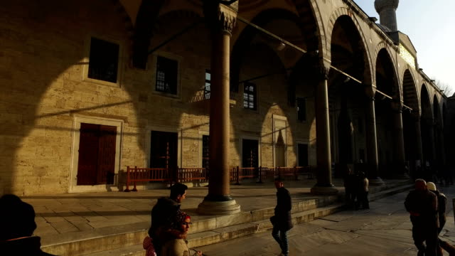 people visit istanbul's famous sultan ahmed mosque known locally as the blue mosque on march 10 2017 in istanbul turkey completed in 1616 the popular... - place of worship stock videos & royalty-free footage