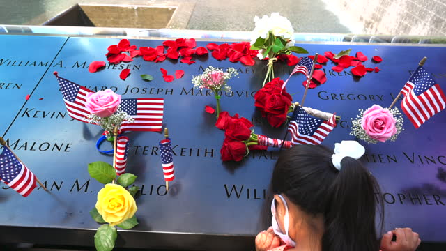 people visit the 9/11 memorial south pool on september 11, 2021 in new york city. the nation is marking the 20th anniversary of the terror attacks of... - baby girls stock videos & royalty-free footage