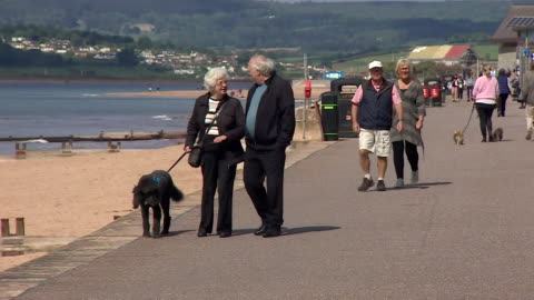 people visit the beach in exmouth, devon, as some coronavirus locdown restrictions begin to be lifted - devon stock videos & royalty-free footage