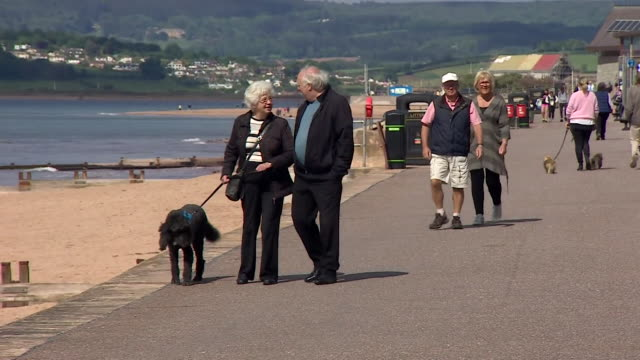 vídeos y material grabado en eventos de stock de people visit the beach in exmouth devon as some coronavirus locdown restrictions begin to be lifted - devon