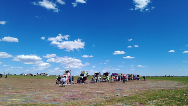 people visit the cadillac ranch car sculptures amid the covid-19 pandemic. - soil stock videos & royalty-free footage
