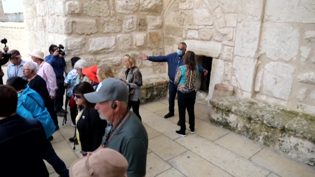 people visit the church of the nativity built on the bethlehem location revered as the birthplace of jesus which is among the sites expected to be... - church stock videos & royalty-free footage