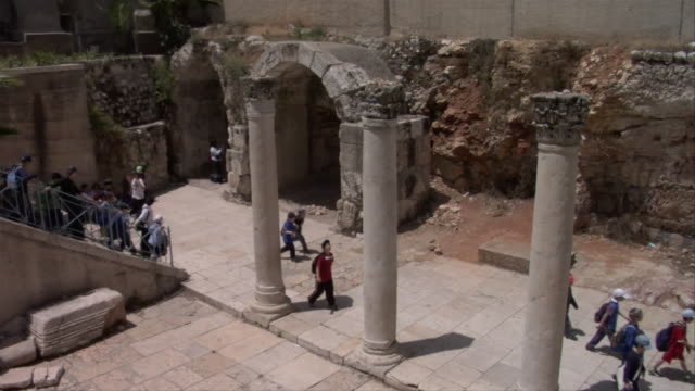 people visit the columns of cardo maximus - jerusalem old city stock videos and b-roll footage