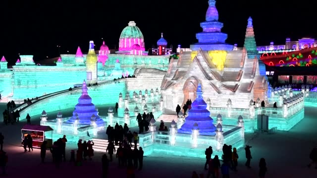 people visit the harbin ice and snow world on the opening day of the annual harbin ice and snow sculpture festival in harbin in china's northeast... - schneefestival stock-videos und b-roll-filmmaterial