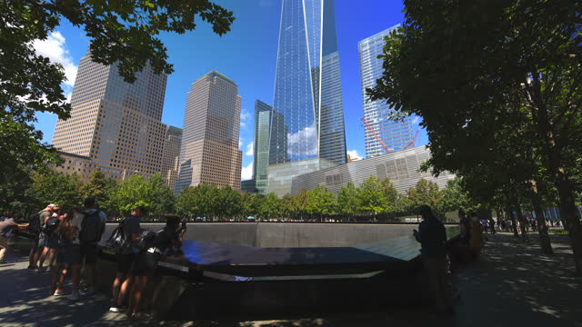 people visit the south pool of the 9/11 memorial during the week of the 20th anniversary of 9/11 on september 6, 2021 in new york city. the memorials... - memorial stock videos & royalty-free footage