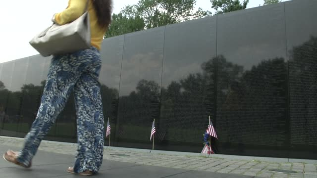 People visit the Vietnam Veterans Memorial in Washington DC It honors US service members of the US armed forces who fought in the Vietnam War service...