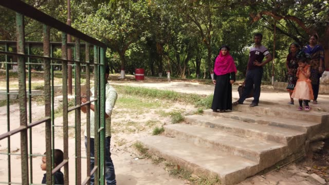 People visit the zoo in Dhaka Bangladesh A pair of rhinoceros was brought to Dhaka zoo from South Africa in 2011 The male died in 2013 This sheep has...