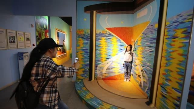 vídeos de stock, filmes e b-roll de people visit van gogh star art museum at kunming joy city on october 26 2019 in kunming yunnan province of china - yunnan province