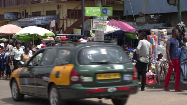 people visiting busy street market in accra the capital of ghana - kenya stock videos & royalty-free footage