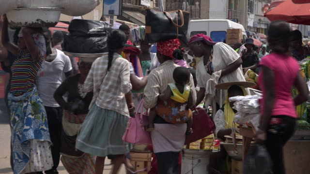 people visiting the busy daily vegetable market in accra - ghana stock videos & royalty-free footage