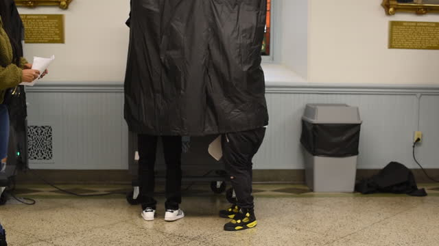 people voting at voting booth behind curtain in 2020 us presidential election in philadelphia, pa, u.s. on tuesday, november 3, 2020. - philadelphia pennsylvania stock-videos und b-roll-filmmaterial