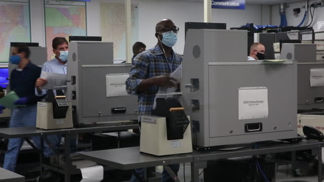 people voting, counting votes in mail-in ballots and drop off boxes at polling stations at miami dade county elections department in miami, florida,... - zählen stock-videos und b-roll-filmmaterial