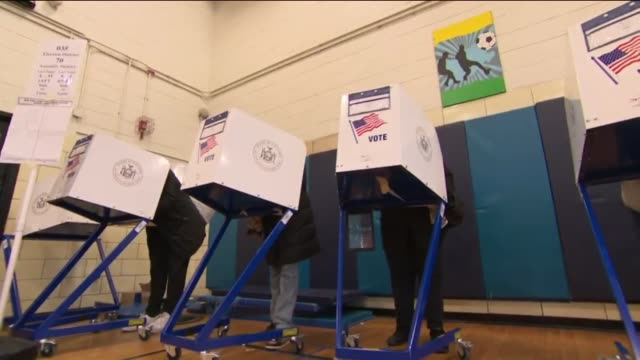 wpix people voting in a harlem polling station in new york on nov 8 2016 - wahllokal stock-videos und b-roll-filmmaterial