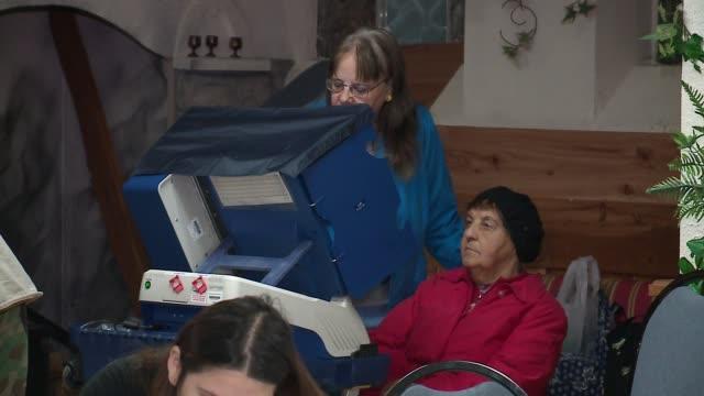 wgn people voting in a polling place on election day in chicago on nov 8 2016 - vallokal bildbanksvideor och videomaterial från bakom kulisserna
