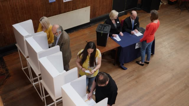 4k aerial: people voting in polling booths at the election - voting at polling station - voting ballot stock videos and b-roll footage