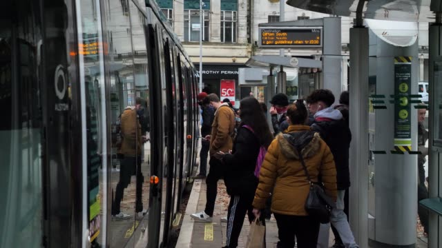 people wait and use for public transport, a local tram. nottingham in tier two as the government looks at placing more restrictions on the city with... - tram stock videos & royalty-free footage