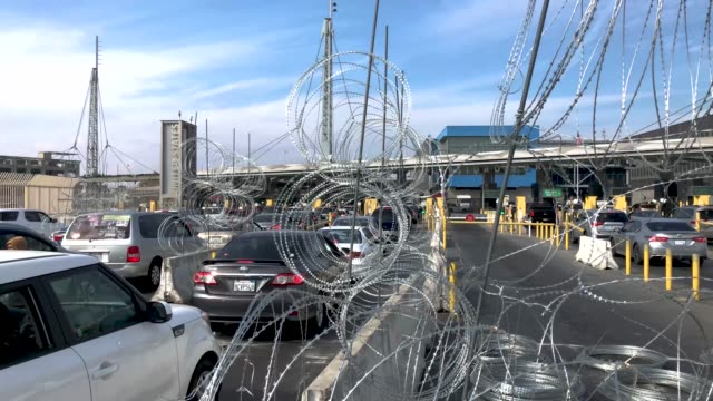 people wait for hours to cross from mexico into the united states at the otay mesa border crossing on november 19 2018 as seen from tijuana mexico... - mesa stock videos and b-roll footage