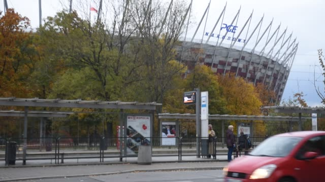 people wait for public transport next to poland's national stadium on october 29, 2020 in warsaw, poland. the iconic stadium was built to host... - temporary stock videos & royalty-free footage