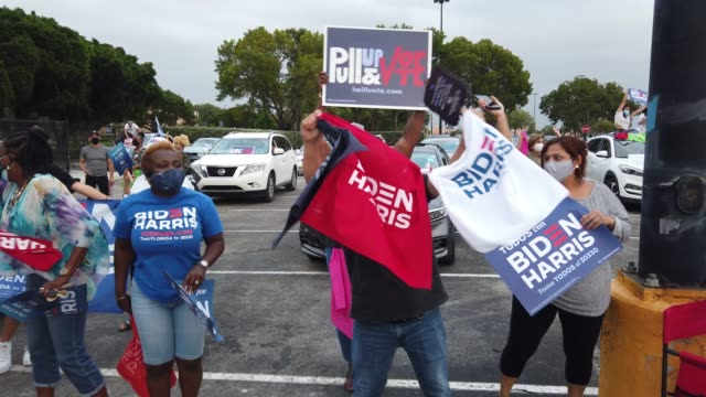 people wait for the arrival of former president barack obama for his drive in campaign rally in support of democratic presidential nominee joe biden... - political rally stock videos & royalty-free footage
