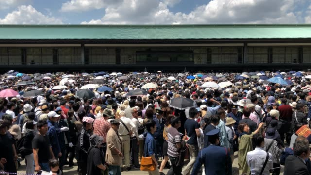 people wait for the first public appearance of japan's emperor naruhito at the imperial palace on may 04 2019 in tokyo japan emperor naruhito has... - japanese royalty stock videos and b-roll footage