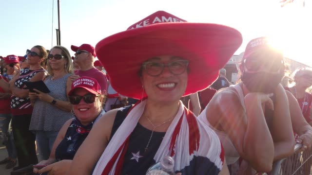 people wait for the start of a campaign rally for president donald trump at the orlando sanford international airport on october 12 2020 in sanford... - florida us state stock videos & royalty-free footage