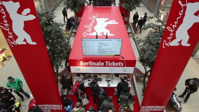 stockvideo's en b-roll-footage met people wait in a line at the potsdamer platz arkaden shopping mall to buy tickets for films at the berlinale international film festival on the first... - internationaal filmfestival van berlijn