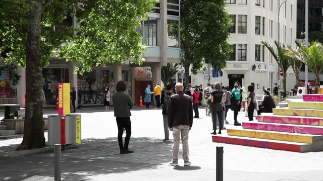 people wait in line at a new pop-up covid-19 testing station in freyberg place on high st near the a-z collection store on high st where a worker has... - new zealand stock-videos und b-roll-filmmaterial