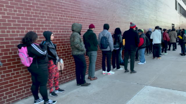 people wait in line for a job fair at a united parcel service facility on november 01, 2019 in new york city. the october employment report, which... - 就職フェア点の映像素材/bロール