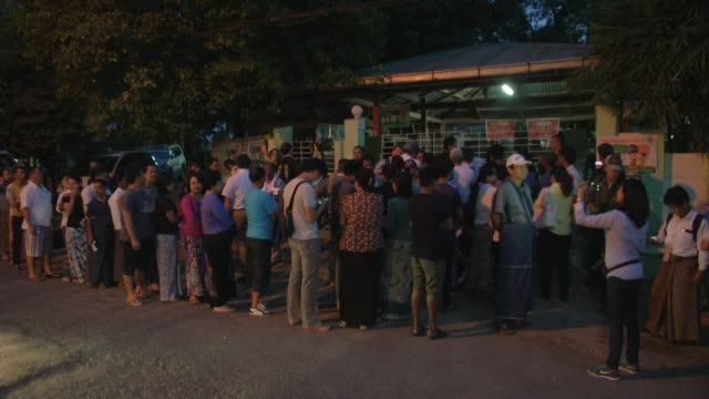 People Wait in line outside a polling station before it opened in Yangon during Myanmar's first free and fair election / The elections will be...